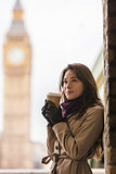 Woman Drinking Coffee by Westminster Bridge, Big Ben, London, En