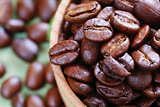 brown coffee beans on a wooden background