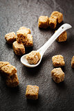 Brown organic sugar cubes close-up
