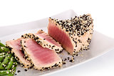 Tuna slices with white and black sesame seeds.
