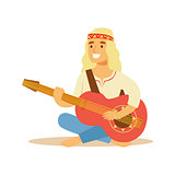 Guy Hippie Dressed In Classic Woodstock Sixties Hippy Subculture Clothes Sitting Barefoot With Guitar