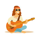 Man Hippie Dressed In Classic Woodstock Sixties Hippy Subculture Clothes Sitting Playing Guitar In Round Shades