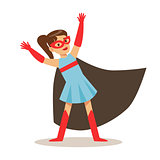 Girl In Blue Dress Pretending To Have Super Powers Dressed In Superhero Costume With Black Cape And Mask Smiling Character