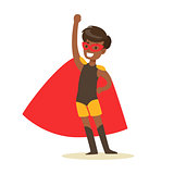 Boy Pretending To Have Super Powers Dressed In Black Superhero Costume With Red Cape And Mask Smiling Character