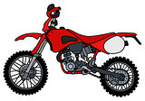 Red off-road racing motorbike
