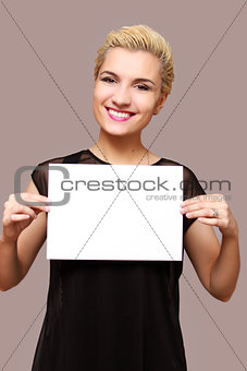 beautiful woman smiling, holding a place for an inscription