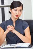 Asian Chinese Woman or Businesswoman in her Office