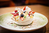 Pavlova, a home made cake from layers of meringue