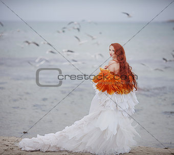 beautiful girl like a swan on the beach