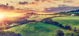 Picturesque sunset over green hills sunshine Italy