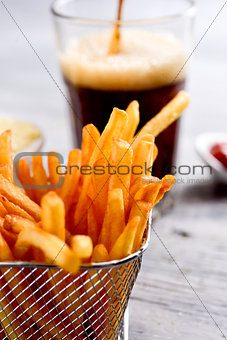 appetizing french fries in a metallic basket