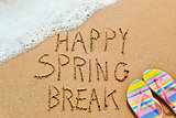 text happy spring break in the sand