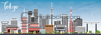 Tokyo Skyline with Gray Buildings and Blue Sky.