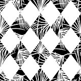 Harlequin rhombs and palm leaves seamless vector pattern.