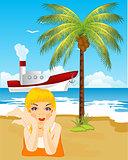 Girl tans on beach