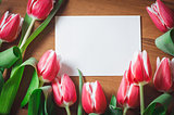 Fresh tulips on a wooden table