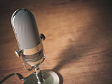 Retro microphone on the table with space for text. Vintage style