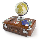 Travel or tourism concept. Old suitcase with stickers, globe and