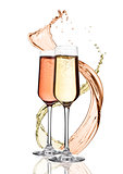 Glasses of yellow and pink champagne with splashes