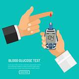 blood glucose meter in hand