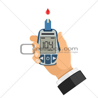 blood glucose meter in hand