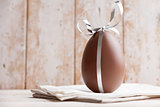 Delicious chocolate Easter egg with a ribbon