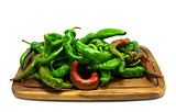 Multicolor hot peppers on wooden kitchen board