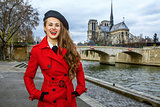 tourist woman on embankment near Notre Dame de Paris