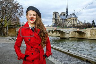 tourist woman on embankment near Notre Dame de Paris