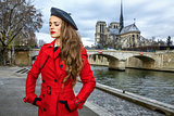 traveller woman on embankment near Notre Dame de Paris