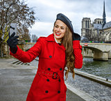 tourist woman taking selfie with cellphone in Paris, France