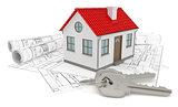A model home and house key on blueprints