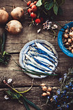 Fresh sardines on wood
