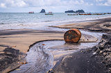 Old rusty barrel oil on beach in Asia