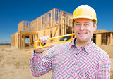 Smiling Male Contractor in Hardhat Holding Blueprints  and Level