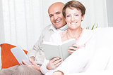 Loving happy couple relaxing reading at home