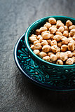 Chick pea in blue authentic bowl on dark