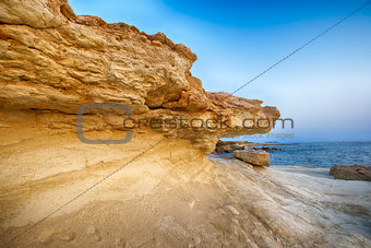 by erosion affected rocks on the sea