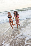 Girls Young Women in Bikinis Running on Beach