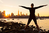 Woman Exercising at Sunrise New York City Skyline