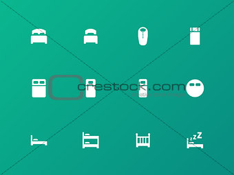 Bed, bunk and sleeping bag icons on green background.
