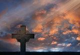 Sunset rays over iron cross
