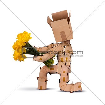 Boxman on bended knee with flowers