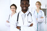 Happy african american male doctor  with medical staff at the hospital