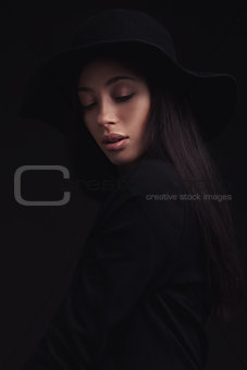 Beautiful woman in retro hat