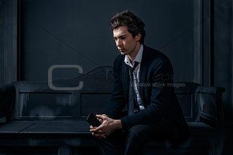 Man in the black suit
