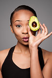 Happy healthy black asian woman with avocado fruit