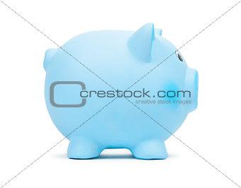 Blue ceramic piggy bank, isolated on white background