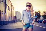 Trendy Hipster Girl at Sunset in the City