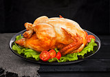 Roasted chicken on black background